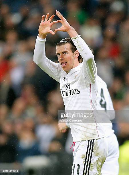 Gareth Bale of Real Madrid celebrates after scoring the opening goal during the La Liga match between Real Madrid and Rayo Vallecano at Estadio...