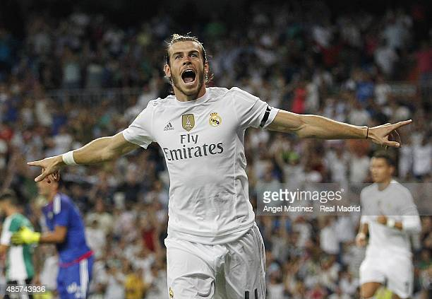 Gareth Bale of Real Madrid celebrates after scoring the opening goal during the La Liga match between Real Madrid CF and Real Betis Balompie at...