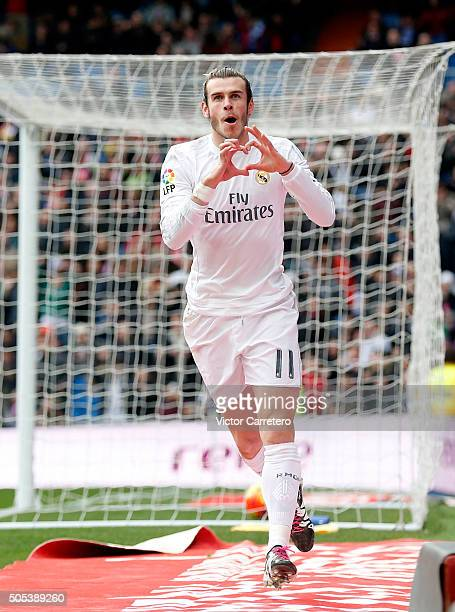 Gareth Bale of Real Madrid celebrates after scoring the opening goal during the La Liga match between Real Madrid CF and Sporting de Gijon at Estadio...