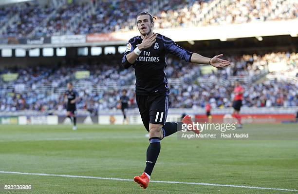 Gareth Bale of Real Madrid celebrates after scoring the opening goal during the La Liga match between Real Sociedad and Real Madrid CF at Estadio...