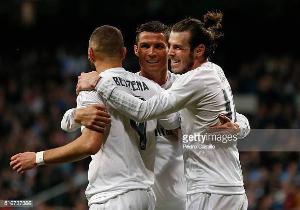 Gareth Bale of Real Madrid celebrates after scoring with his teammates Karims Benzema and Cristiano Ronaldo during the La Liga match between Real...