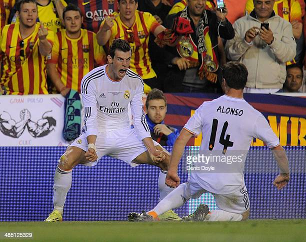Gareth Bale of Real Madrid celebrates beside Xabi Alonso after scoring Real's 2nd goal during the Copa del Rey Final between Real Madrid and...