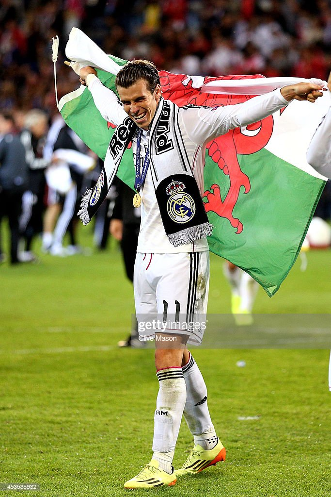 Gareth Bale of Real Madrid celebrates following his team's 2-0 victory during the UEFA Super Cup between Real Madrid and Sevilla FC at Cardiff City Stadium on August 12, 2014 in Cardiff, Wales.