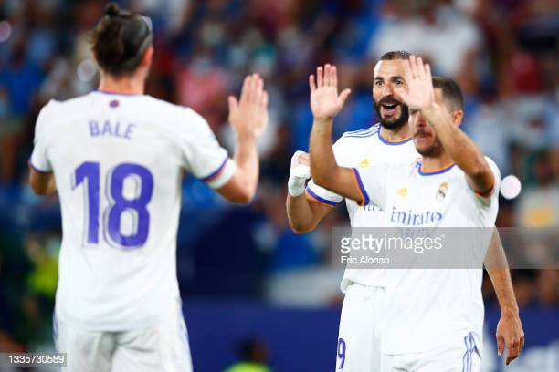 Gareth Bale of Real Madrid celebrates scoring his side's first goal with Karim Benzema and Eden Hazard of Real Madrid during the La Liga Santader...