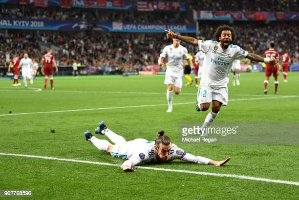 Gareth Bale of Real Madrid celebrates scoring his side's second goal with team mate Marcelo during the UEFA Champions League Final between Real...