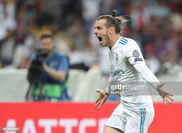 Gareth Bale of Real Madrid celebrates scoring his side's second goal during the UEFA Champions League Final between Real Madrid and Liverpool at NSC...