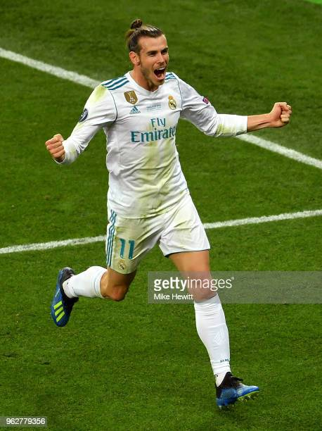 Gareth Bale of Real Madrid celebrates scoring his sides third goal his second during the UEFA Champions League Final between Real Madrid and...
