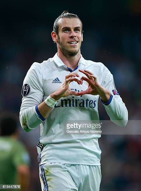 Gareth Bale of Real Madrid celebrates scoring his team's first goal during the UEFA Champions League Group F match between Real Madrid CF and Legia...