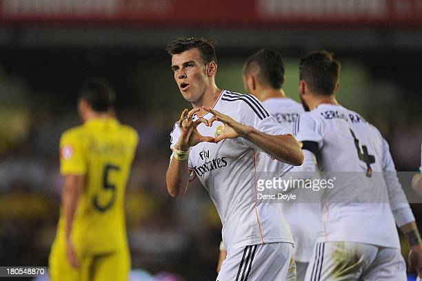 Gareth Bale of Real Madrid celebrates scoring Real's opening goal during the La Liga match between Villarreal and Real Madrid at El Madrigal on...