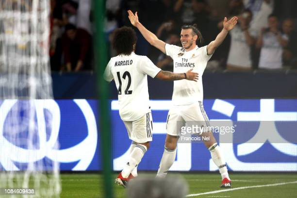 Gareth Bale of Real Madrid celebrates scoring the third goal and his hattrick with Marcelo of Real Madrid during the FIFA Club World Cup semifinal...