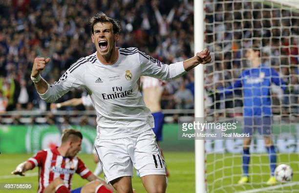 Gareth Bale of Real Madrid celebrates scoring their second goal in extra time during the UEFA Champions League Final between Real Madrid and Atletico...