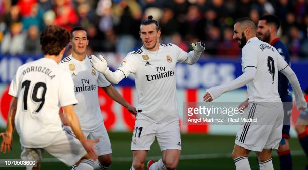 Gareth Bale of Real Madrid celebrates with Alvaro Odriozola after scoring the opening goal during the La Liga match between SD Huesca and Real Madrid...