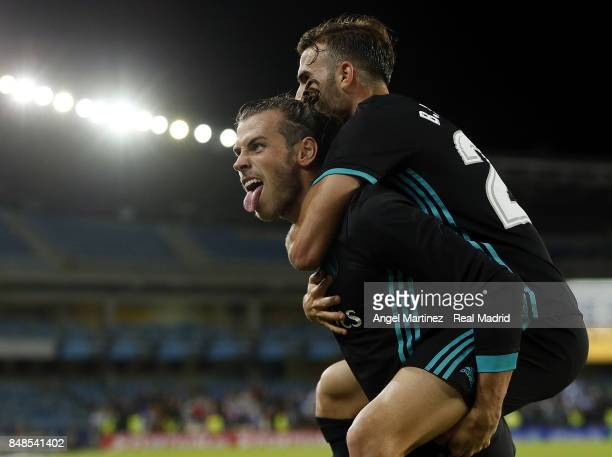 Gareth Bale of Real Madrid celebrates with Borja Mayoral after scoring their team's third goal during the La Liga match between Real Sociedad and...