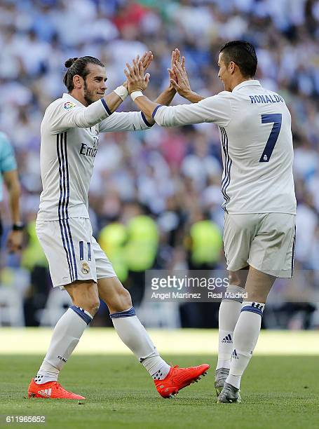 Gareth Bale of Real Madrid celebrates with Cristiano Ronaldo after scoring their team's first goal during the La Liga match between Real Madrid CF...