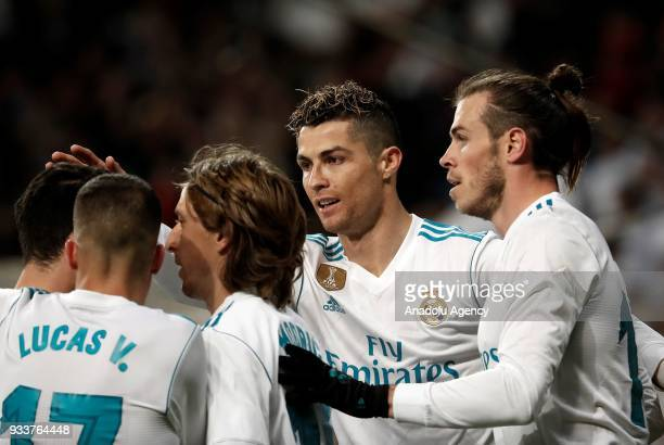 Gareth Bale of Real Madrid celebrates with Cristiano Ronaldo and Luka Modric after scoring a goal during the La Liga soccer match between Real Madrid...
