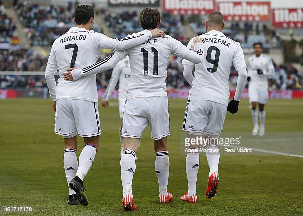 Gareth Bale of Real Madrid celebrates with Cristiano Ronaldo and Karim Benzema after scoring their team's second goal during the La Liga match...