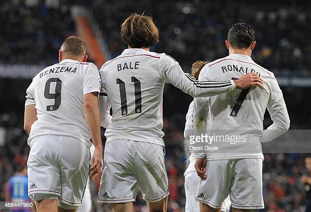 Gareth Bale of Real Madrid celebrates with Cristiano Ronaldo and Karim Benzema after scoring Real's opening goal during the La Liga match between...
