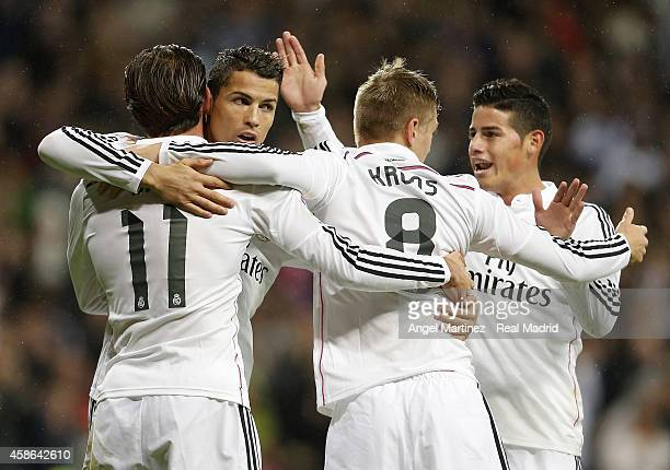 Gareth Bale of Real Madrid celebrates with Cristiano Ronaldo Toni Kroos and James Rodriguez after scoring the opening goal during the La Liga match...