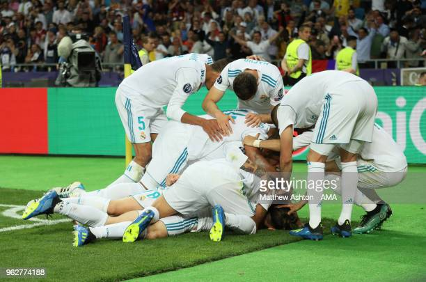 Gareth Bale of Real Madrid celebrates with his team mates after scoring a goal to make it 21 during the UEFA Champions League final between Real...