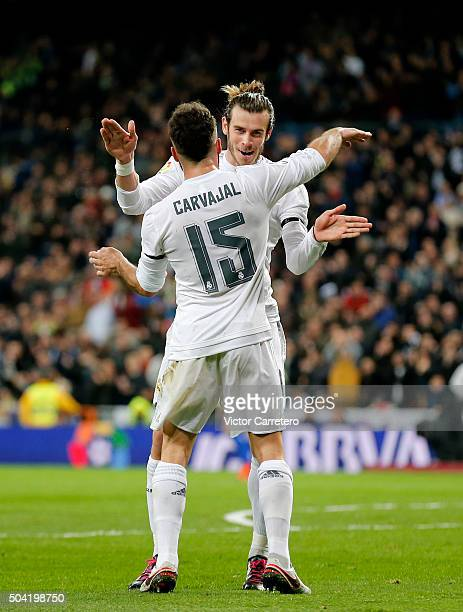 Gareth Bale of Real Madrid celebrates with his teammate Daniel Carvajal after scoring his team's second goal during the La Liga match between Real...