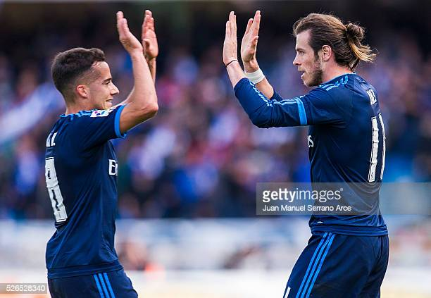 Gareth Bale of Real Madrid celebrates with his teammate Lucas Vazquez of Real Madrid after scoring the opening goal during the La Liga match between...