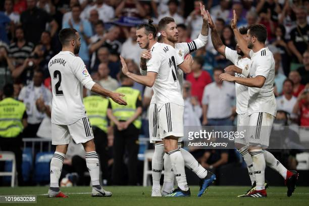 Gareth Bale of Real Madrid celebrates with his teammates Dani Carvajal and Sergio Ramos after scoring a goal during La Liga soccer match between Real...