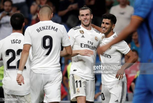 Gareth Bale of Real Madrid celebrates with his teammates Marco Asensio Isco and Karim Benzema after scoring a goal during La Liga soccer match...