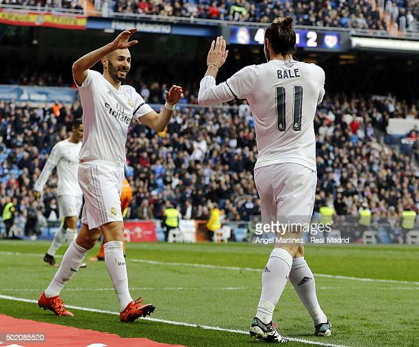 Gareth Bale of Real Madrid celebrates with Karim Benzema after scoring their team's fourth goal during the La Liga match between Real Madrid CF and...