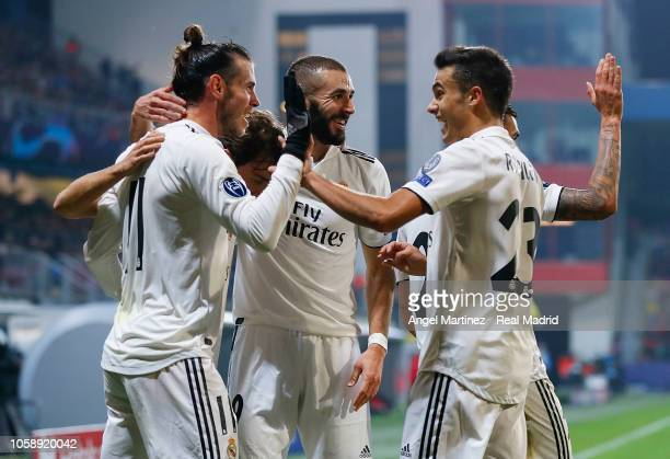 Gareth Bale of Real Madrid celebrates with Karim Benzema and Segio Reguilon after scoring their team's fourth goal during the Group G match of the...
