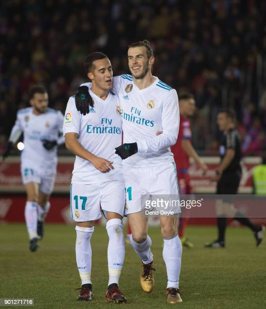 Gareth Bale of Real Madrid celebrates with Lucas Vazquez after scoring his team's opening goal from the penalty spot during the Copa del Rey match...