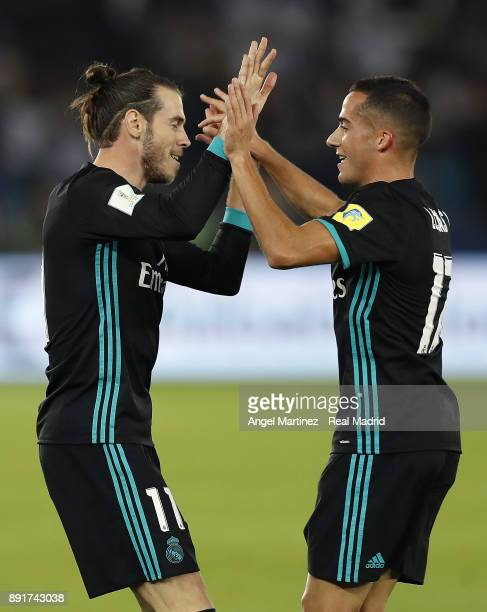 Gareth Bale of Real Madrid celebrates with Lucas Vazquez after scoring their team's second goal during the FIFA Club World Cup UAE 2017 semifinal...