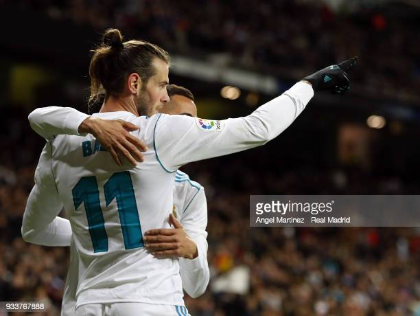 Gareth Bale of Real Madrid celebrates with Lucas Vazquez after scoring their team's fifth goal during the La Liga match between Real Madrid and...