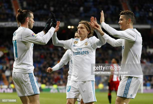 Gareth Bale of Real Madrid celebrates with Luka Modric and Cristiano Ronaldo after scoring their team's fifth goal during the La Liga match between...