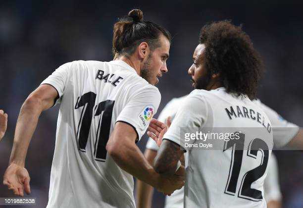 Gareth Bale of Real Madrid celebrates with Marcelo after scoring his team's second goal during the La Liga match between Real Madrid CF and Getafe CF...
