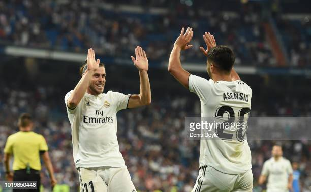Gareth Bale of Real Madrid celebrates with Marco Asensio after scoring his teams second goal during the La Liga match between Real Madrid CF and...