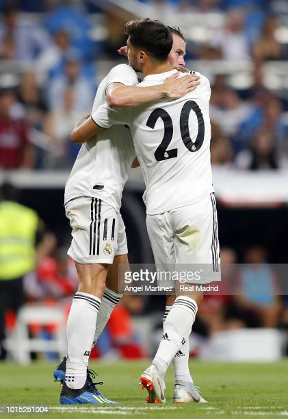 Gareth Bale of Real Madrid celebrates with Marco Asensio after scoring their team's second goal during the Trofeo Santiago Bernabeu match between...