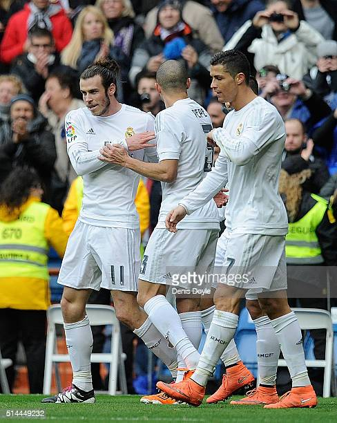 Gareth Bale of Real Madrid celebrates with Pepe and Cristiano Ronaldo after scoring his side's 7th goal during the La Liga match between Real Madrid...