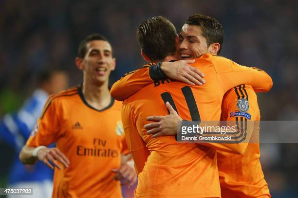 Gareth Bale of Real Madrid celebrates with team mate Cristiano Ronaldo after scoring his team's second goal during the UEFA Champions League Round of...