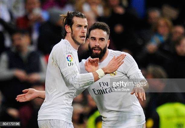 Gareth Bale of Real Madrid celebrates with team mate Daniel Carvajal as he scores their fourth goaland completes his hat trick during the La Liga...
