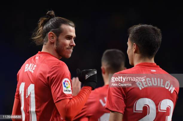 Gareth Bale of Real Madrid celebrates with team mate Sergio Reguilon after scoring their team's fourth goal during the La Liga match between RCD...