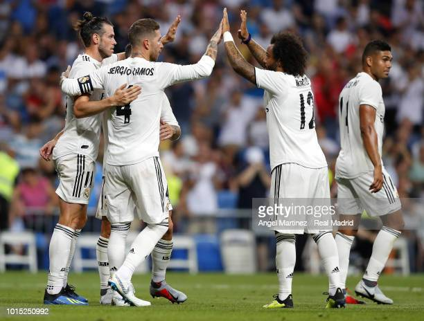 Gareth Bale of Real Madrid celebrates with team mates after scoring their team's second goal during the Trofeo Santiago Bernabeu match between Real...