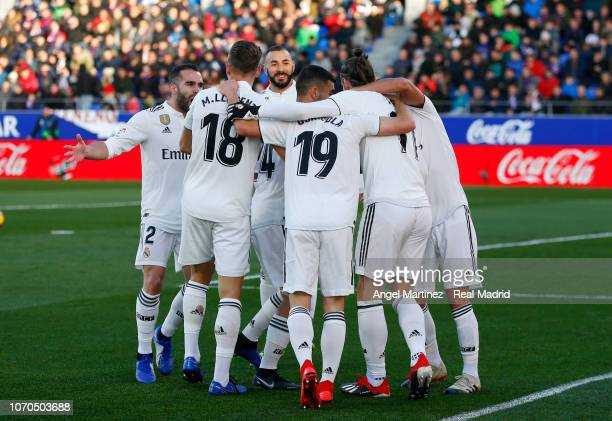Gareth Bale of Real Madrid celebrates with team mates after scoring the opening goal during the La Liga match between SD Huesca and Real Madrid CF at...