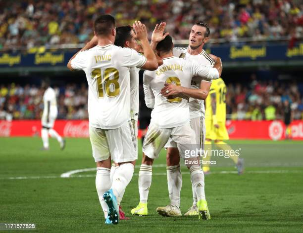 Gareth Bale of Real Madrid celebrates with team mates after scoring his sides first goal during the Liga match between Villarreal CF and Real Madrid...