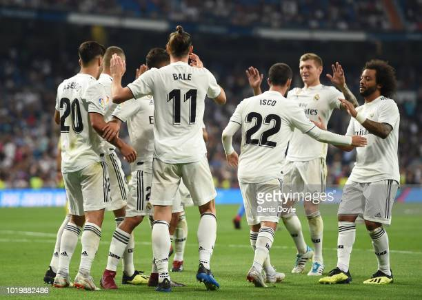 Gareth Bale of Real Madrid celebrates with teammates after scoring his team's second goal during the La Liga match between Real Madrid CF and Getafe...