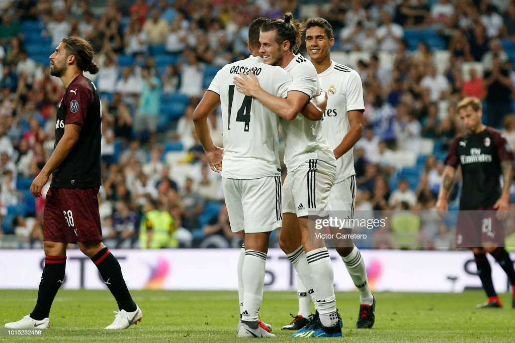 Gareth Bale (C) of Real Madrid celebrates with teammates Casemiro (L) and Raphael Varane after scoring his team's second goal during the Trofeo Santiago Bernabeu match between Real Madrid and AC Milan at Estadio Santiago Bernabeu on August 11, 2018 in Madrid, Spain.