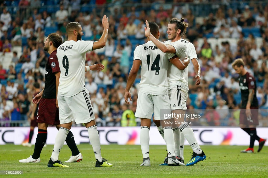 Gareth Bale (R) of Real Madrid celebrates with teammates Karim Benzema (L) and Casemiro after scoring his team's second goal during the Trofeo Santiago Bernabeu match between Real Madrid and AC Milan at Estadio Santiago Bernabeu on August 11, 2018 in Madrid, Spain.
