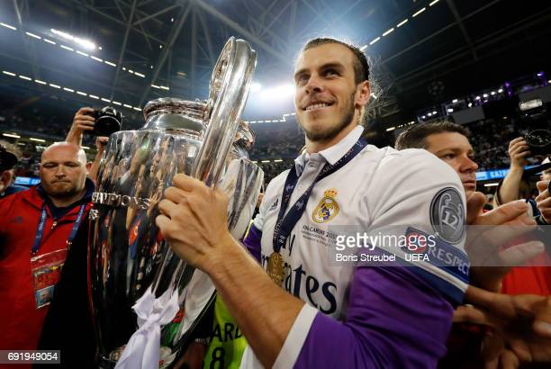 Gareth Bale of Real Madrid celebrates with The Champions League trophy after the UEFA Champions League Final between Juventus and Real Madrid at...