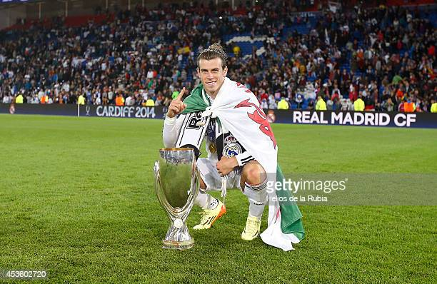 Gareth Bale of Real Madrid celebrates with the trophy following his team's 20 victory during the UEFA Super Cup between Real Madrid and Sevilla FC at...