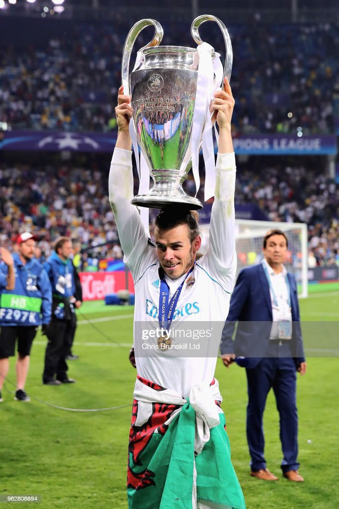 Gareth Bale of Real Madrid celebrates with the UEFA Champions League trophy after his side won the UEFA Champions League final between Real Madrid and Liverpool at NSC Olimpiyskiy Stadium on May 26, 2018 in Kiev, Ukraine.