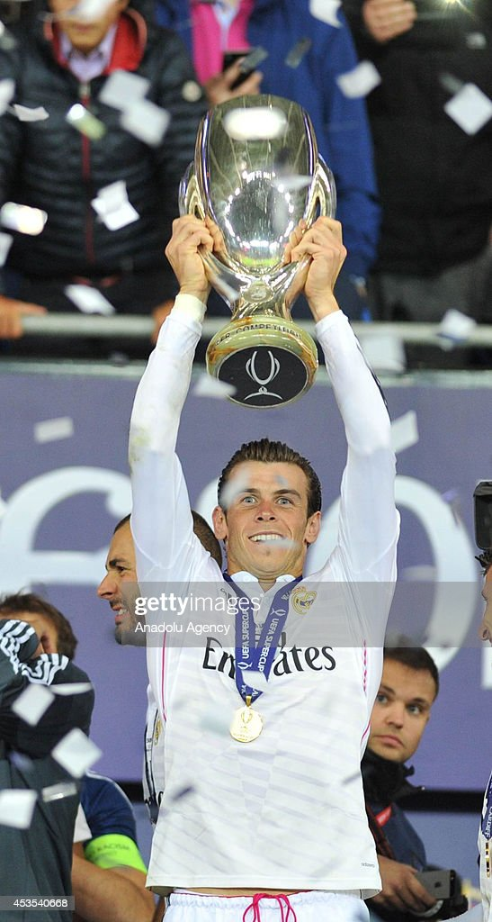 Gareth Bale of Real Madrid celebrates with the UEFA Super Cup after winning the UEFA Super Cup football match between Real Madrid and FC Sevilla on August 12, 2014 at Cardiff City Stadium in Cardiff, Wales on August 12, 2014.